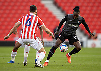 31st October 2020; Bet365 Stadium, Stoke, Staffordshire, England; English Football League Championship Football, Stoke City versus Rotherham United; Freddie Ladapo of Rotherham United under pressure from Danny Batth of Stoke City