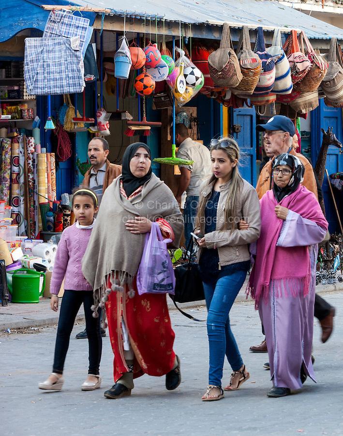 Essaouira, Morocco.  Women's Dress Styles: Modern vs. Conservative, Traditional.  Avenue de l'Istiqlal.