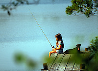 8 YEAR OLD GIRL FISHING ON DOCK WITH PUPPY  DOG DOGS PETS BEST FRIENDS SOLITUDE CHILD CHILDREN. ANNMARIE CAMPBELL. OCALA FLORIDA, OCALA NATIONAL FOREST.