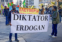 "Pictured: Kurdish protesters with an ""Diktator Erdogan"" banner gather at Syntagma Square in Athens Greece. <br /> Re: Kurdish people with protest against the Turkey president  Recep Tayyip Erdogan's visit to Greece. Thursday 07 December 2017"