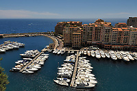 "View on the Principality of Monaco, Mediterranean Sea. The photo shows the Port Nikolas Flores harbour in the Condamine ward. In the background, the Monte Carlo ward is the principal residential and resort area with the casino in the east and northeast. The picture has been taken from the place in front of The Palace in Monaco-Ville ward the old city which is on a rocky promontory known as Rock of Monaco (in French ""Le Rocher""). Monaco is the second smallest country in the world after Vatican City."