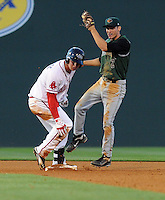 Shortstop Kelby Tomlinson (2) of the Augusta GreenJackets makes the tag as David Renfroe (16) of the Greenville Drive is called out stealing in a game on April 19, 2012, at Fluor Field at the West End in Greenville, South Carolina. (Tom Priddy/Four Seam Images)