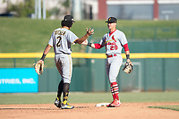 Surprise Saguaros infielders Cole Tucker (2) and Andy Young (29) celebrate a victory after an Arizona Fall League game against the Mesa Solar Sox at Sloan Park on November 1, 2018 in Mesa, Arizona. Surprise defeated Mesa 5-4 . (Zachary Lucy/Four Seam Images)