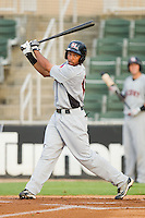 Jared Bolden #15 of the Hickory Crawdads follows through on his swing against the Kannapolis Intimidators at Fieldcrest Cannon Stadium August 18, 2010, in Kannapolis, North Carolina.  Photo by Brian Westerholt / Four Seam Images