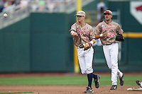 Virginia Cavaliers second baseman Ernie Clement (4) makes a throw to first base against the Arkansas Razorbacks in Game 1 of the NCAA College World Series on June 13, 2015 at TD Ameritrade Park in Omaha, Nebraska. Virginia defeated Arkansas 5-3. (Andrew Woolley/Four Seam Images)
