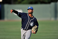 Pitcher Jesus Tinoco (34) of the Asheville Tourists warms up before a game against the Greenville Drive on Thursday, August 13, 2015, at Fluor Field at the West End in Greenville, South Carolina. Asheville won, 8-1. (Tom Priddy/Four Seam Images)