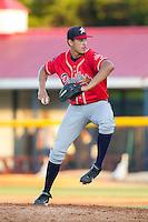 Danville Braves starting pitcher Alec Grosser (24) at bat against the Burlington Royals at Burlington Athletic Park on July 5, 2014 in Burlington, North Carolina.  The Royals defeated the Braves 5-4.  (Brian Westerholt/Four Seam Images)