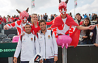 16-09-12, Netherlands, Amsterdam, Tennis, Daviscup Netherlands-Suisse, Suisse fans posing with Dutch players Jean-Julien Rojer and Robin Haase(R)