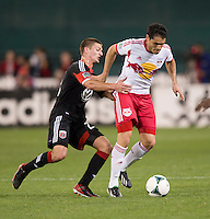 Perry Kitchen (23) of D.C. United tries to stop Fabian Espindola (9) of New York Red Bulls during the game at RFK Stadium in Washington, DC.  New York Red Bulls defeated D.C. United, 2-0.