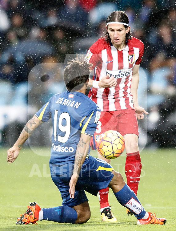 Getafe's Damian Suarez (l) and Atletico de Madrid's Filipe Luis during La Liga match. February 14,2016. (ALTERPHOTOS/Acero)