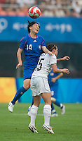 Japanese defender (14) Kyoko Yano goes up for a header over New Zealand forward (15) Emma Kete during first round play in the 2008 Beijing Olympics at Qinhuangdao, China. .  Japan tied New Zealand, 2-2, at Qinhuangdao Stadium.