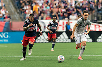 FOXBOROUGH, MA - JULY 25: Gustavo Bou #7 of New England Revolution brings the ball forward as Lassi Lappalainen #21 of CF Montreal defends during a game between CF Montreal and New England Revolution at Gillette Stadium on July 25, 2021 in Foxborough, Massachusetts.