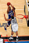 Kentucky forward Randolph Morris (33) shoots over Connecticut center Josh Boone (21).  Connecticut defeated Kentucky 87-83 in the second round of the NCAA Tournament  at the Wachovia Center in Philadelphia, Pennsylvania on March 19, 2006.