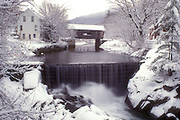 AJ5982, waterfall, covered bridge, river, winter, snow, Mad River Valley, Warren Covered Bridge c. 1880 crosses over the Mad River as it cascades over the snow covered wall of rocks on on a wintry day in Warren in Washington County in the state of Vermont.