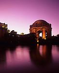 Palace of Fine Art illuminated at night with reflections in small lake, San Francisco, California USA