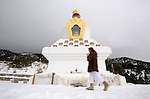 Elianna Krakauer, of Crestone, circles the Tashi Gomang Stupa in Crestone, CO during a personal meditation. Michael Brands for The New York Times.