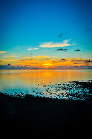 Sunset at Amuri Beach, Aitutaki Island, Cook Islands.