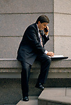 City of London  business man during his lunch hour takes a call on his new style mobile phone. 1992.  1990s UK
