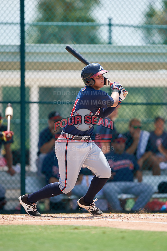 GCL Braves catcher Abrahan Gutierrez (4) follows through on a swing during a game against the GCL Pirates on July 26, 2017 at Pirate City in Bradenton, Florida.  GCL Braves defeated the GCL Pirates 12-5.  (Mike Janes/Four Seam Images)