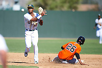 Oakland Athletics minor league infielder Addison Russell #11 attempts to turn a double play as Hector Mercedes #26 slides in during an instructional league game against the San Francisco Giants at the Papago Park Baseball Complex on October 17, 2012 in Phoenix, Arizona. (Mike Janes/Four Seam Images)
