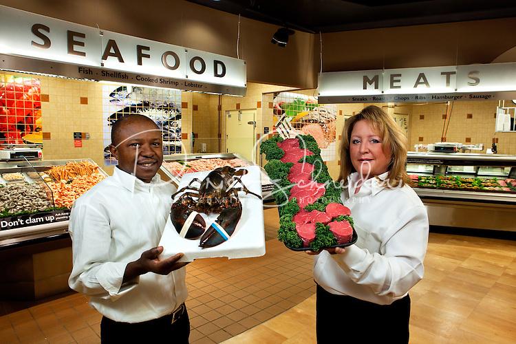 New Bloom Seafood Coordinator Tony Onyenagiri (left) and Market Manager Stephanie Brooks (right).