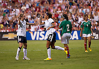 Sydney Leroux (2) of the USWNT celebrates her goal with teammate Heather O'Reilly (9) during an international friendly at RFK Stadium in Washington, DC.  The USWNT defeated Mexico, 7-0.