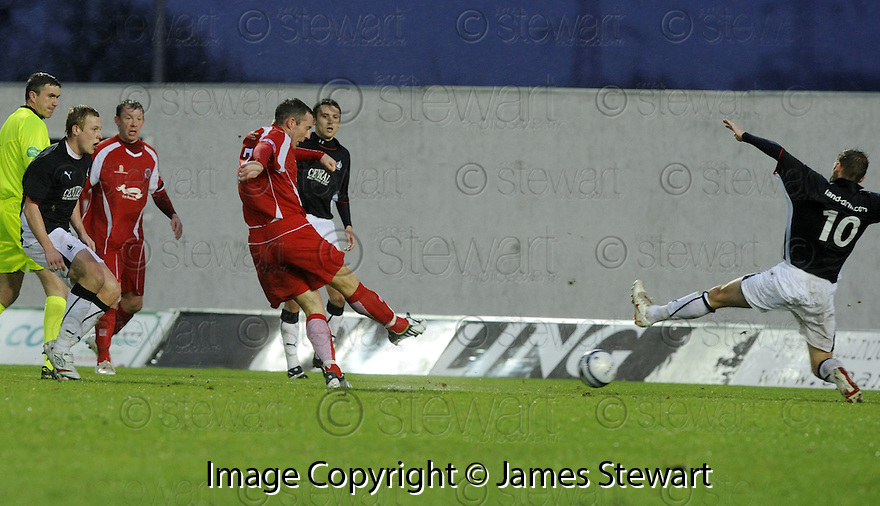 10/01/2009  Copyright Pic: James Stewart.File Name : sct_jspa01_falkirk_v_qots.BARRY WILSON SCORES QUEEN OF THE SOUTH'S FIRST.James Stewart Photo Agency 19 Carronlea Drive, Falkirk. FK2 8DN      Vat Reg No. 607 6932 25.Studio      : +44 (0)1324 611191 .Mobile      : +44 (0)7721 416997.E-mail  :  jim@jspa.co.uk.If you require further information then contact Jim Stewart on any of the numbers above.........