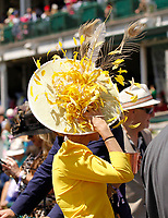 1st May 2021; Kentucky, USA;  This fan holds onto her hat during the 147th running of the Kentucky Derby on May 01st, 2021 at Churchill Downs in Louisville,  Kentucky, USA.