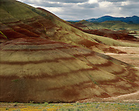Storm clouds building over the eroded hills in the Painted Hills Unit; Jophn Day Fossil Beds National Monument, OR