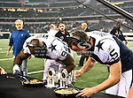 Dallas Cowboys outside linebacker DeMarcus Ware (94) and Dallas Cowboys kicker Dan Bailey (5) in action during the Thanksgiving Day game between the Miami Dolphins and the Dallas Cowboys at the Cowboys Stadium in Arlington, Texas. Dallas defeats Miami 20 to 19...
