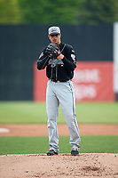 Lansing Lugnuts starting pitcher Andy Ravel (26) gets ready to deliver a pitch during a game against the Clinton LumberKings on May 9, 2017 at Ashford University Field in Clinton, Iowa.  Lansing defeated Clinton 11-6.  (Mike Janes/Four Seam Images)