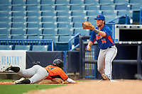 Cole Halfacre (16) of Tate High School in Cantonment, Florida playing for the New York Mets scout team stretches for a throw as Tyler Daughtry (3) dives back to the bag during the East Coast Pro Showcase on July 28, 2015 at George M. Steinbrenner Field in Tampa, Florida.  (Mike Janes/Four Seam Images)