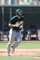 Shane Peterson #10 of the Oakland Athletics runs to first base during a Minor League Spring Training Game against the Los Angeles Angels at the Los Angeles Angels Spring Training Complex on March 17, 2014 in Tempe, Arizona. (Larry Goren/Four Seam Images)
