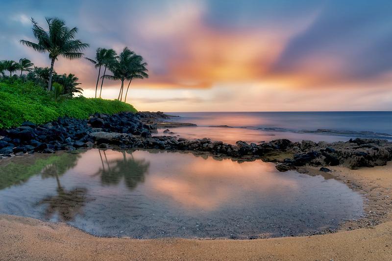 Reflecting pool and sunrise., Keiki Cove.  Poipu, Kauai, Hawaii