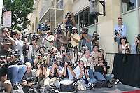 Photographers.Zellweger Receives Star on the.Hollywood Walk of Fame.Los Angeles, CA.May 24, 2005.©2005 Kathy Hutchins / Hutchins Photo