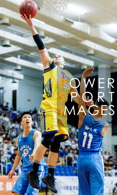 Kepkey Tyler Alexander #55 of Winling Basketball Club tries to score during the Hong Kong Basketball League game between Winling and Fukien at Southorn Stadium on May 29, 2018 in Hong Kong. Photo by Yu Chun Christopher Wong / Power Sport Images