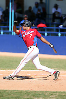 Carlos Gomez works out at the Dominican Republic air force base in front of 100+ Major League Baseball scouts prior to being declared eligible to sign since defecting from his native Cuba in Santo Domingo, Dominican Republic on February 11, 2015 (Bill Mitchell)