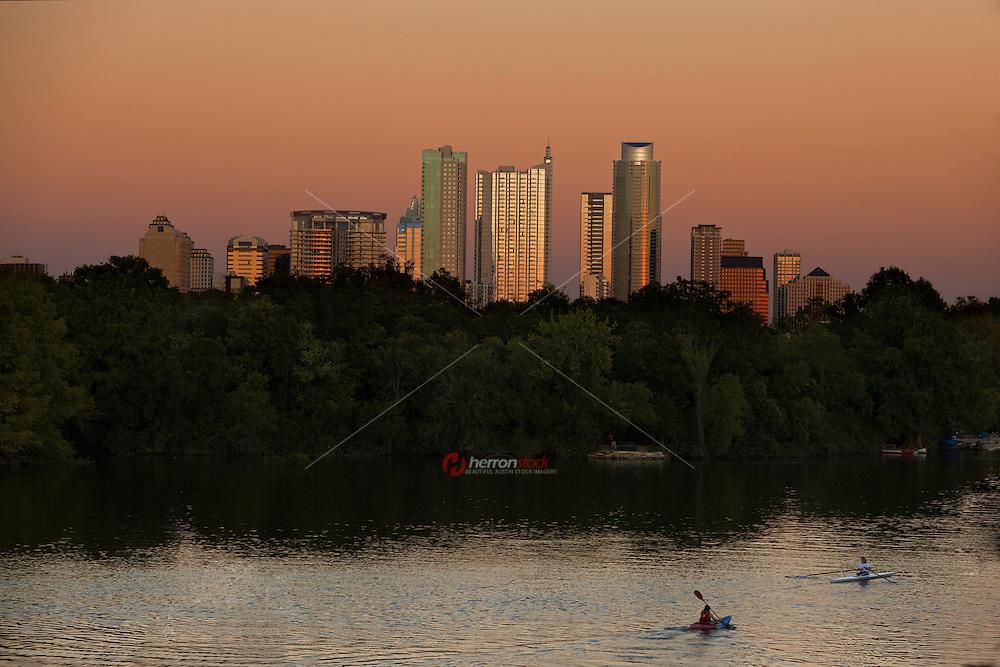 Spectacular orange Austin Skyline at Sunset over Lady Bird Lake.