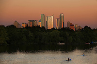 Spectacular orange Austin Skyline at Sunset over Lady Bird Lake.