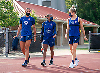 CLEVELAND, OH - SEPTEMBER 14: Lynn Williams, Crystal Dunn and Kristie Mewis of the United States walk onto the field during a training session at the training fields on September 14, 2021 in Cleveland, Ohio.