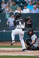 Jeremiah Burks (4) of the Winston-Salem Dash at bat against the Asheville Tourists at Truist Stadium on September 17, 2021 in Winston-Salem, North Carolina. (Brian Westerholt/Four Seam Images)
