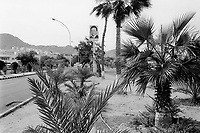 Jordan. Aqaba. Portrait of King Abdullah II and palm trees.  His Majesty King Abdullah II bin Al Hussein, is the actual King of The Hashemite Kingdom of Jordan.His Majesty King Abdullah II bin Al Hussein is the 43rd generation direct descendant of the Prophet Muhammad. He assumed his constitutional powers as Monarch of the Hashemite Kingdom of Jordan on February 7th, 1999. © 2002 Didier Ruef