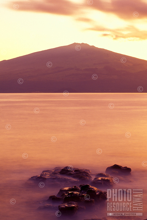 Sunrise view of Haleakala crater taken from across the channel on the Island of Kahoolawe