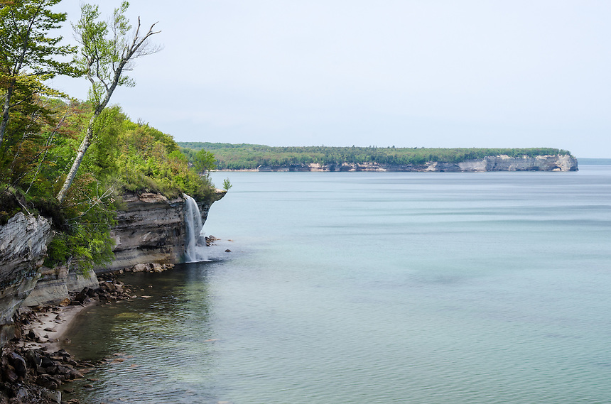 Spray Falls flowing into Lake Superior at Pictured Rocks. Munising, MI