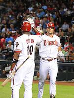 Apr. 30, 2008; Phoenix, AZ, USA; Arizona Diamondbacks outfielder Justin Upton congratulates Conor Jackson (right) after his fourth inning home run against the Houston Astros at Chase Field. Mandatory Credit: Mark J. Rebilas-