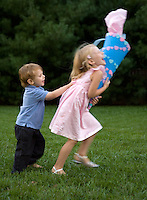 Girl running away from little brother