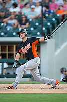 Paul Janish (11) of the Norfolk Tides follows through on his swing against the Charlotte Knights at BB&T BallPark on July 17, 2015 in Charlotte, North Carolina.  The Knights defeated the Tides 5-4.  (Brian Westerholt/Four Seam Images)