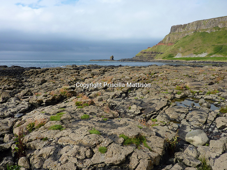 County Antrim, Northern Ireland - July 14, 2010:  The coastline is rugged at the Giant's Causeway.