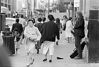 Le Centre-Ville de Montreal dans les années 80<br /> <br /> Saxophoniste sur la rue Ste-Catherine, Juin 1988<br /> <br /> Montreal downtown , in the eighties.