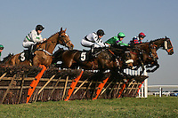"""The field in jumping action during the Call Star Sports On 08000 521321 """"National Hunt"""" Novices Hurdle - Horse Racing at Plumpton Racecourse, East Sussex - 12/03/12 - MANDATORY CREDIT: Gavin Ellis/TGSPHOTO - Self billing applies where appropriate - 0845 094 6026 - contact@tgsphoto.co.uk - NO UNPAID USE."""